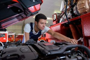 specialist truck mechanic in the car service